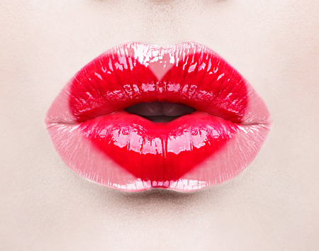 Foto de Beauty sexy lips with heart shape paint. Valentines Day - Imagen libre de derechos