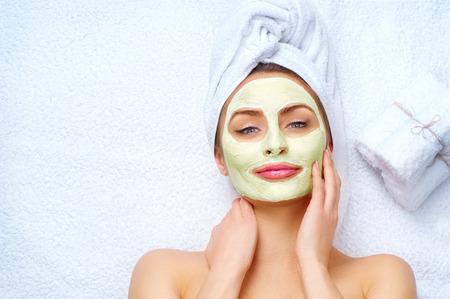 Photo pour Spa woman applying facial clay mask - image libre de droit