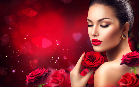 Beauty romantic woman with red rose flowers. Valentines dayの写真素材