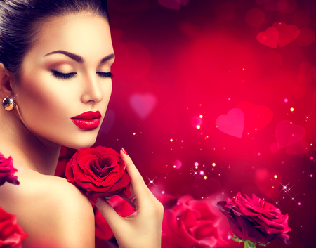 Foto de Beauty romantic woman with red rose flowers. Valentines day - Imagen libre de derechos