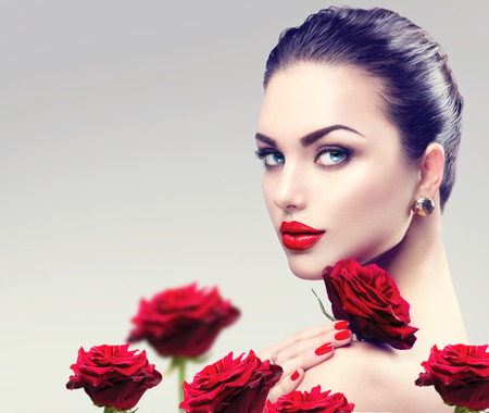 Photo pour Beauty fashion model woman face. Portrait with red rose flowers - image libre de droit
