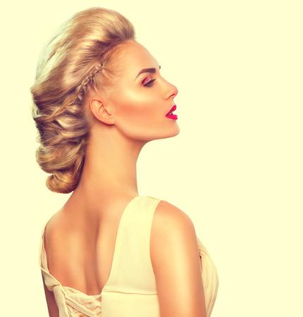 Foto de Fashion model girl portrait with updo hairstyle - Imagen libre de derechos