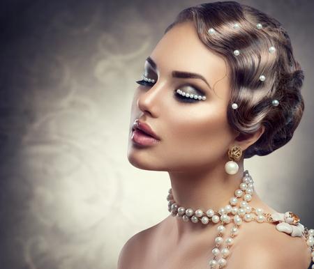 Photo pour Retro styled makeup with pearls. Beautiful Young woman portrait - image libre de droit