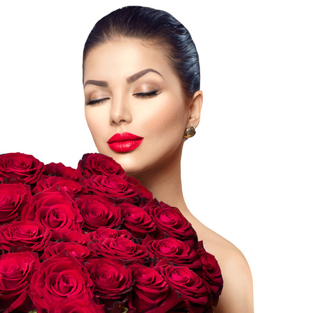 Beauty fashion model woman with big bouquet of red rosesの写真素材