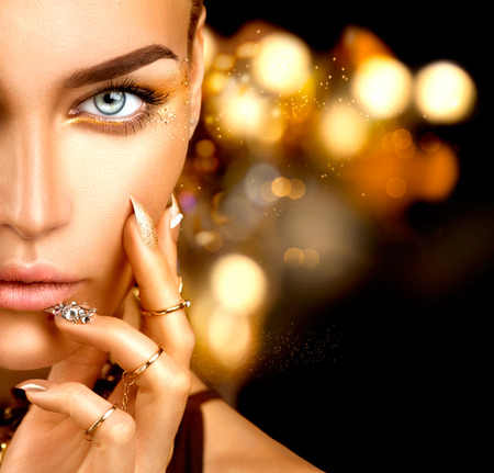 Photo for Beauty fashion woman with golden makeup, accessories and nails - Royalty Free Image