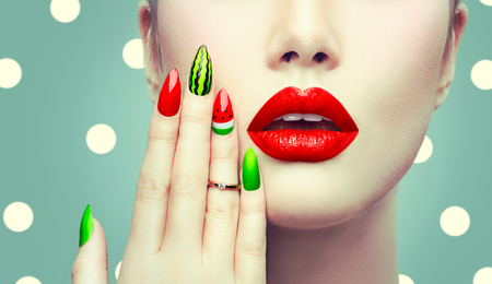 Photo pour Watermelon nail art and makeup closeup over polka dots background - image libre de droit