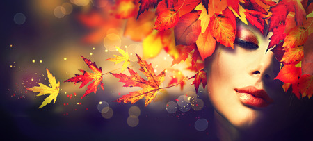 Photo pour Fall. Beauty model girl with colourful autumn leaves hairstyle - image libre de droit