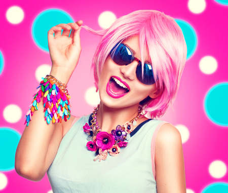 Photo pour Beauty teenage model girl with pink hair, fashion colorful accessories and sunglasses - image libre de droit