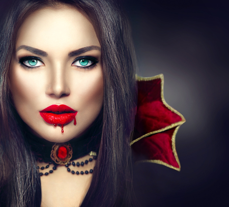 Photo for Halloween vampire woman portrait. Sexy vampire girl with dripping blood on her mouth - Royalty Free Image