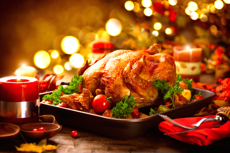Photo for Thanksgiving table served with turkey, decorated with bright autumn leaves - Royalty Free Image