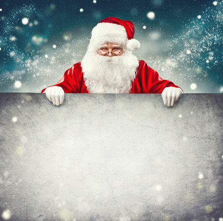 Santa Claus holding blank advertisement banner background with copy space for text