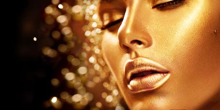 Beauty model girl with golden skin. Fashion art portrait