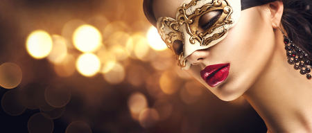 Photo pour Beauty model woman wearing venetian masquerade carnival mask at party. Christmas and New Year celebration - image libre de droit