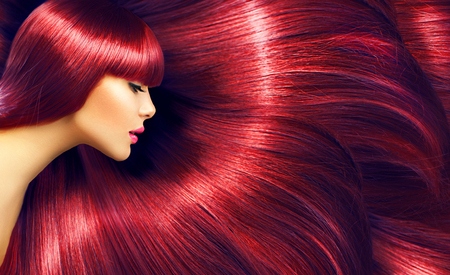 Photo pour Beautiful hair. Beauty brunette woman with long straight red hair as background - image libre de droit