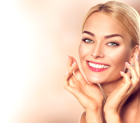 Photo for Beauty woman portrait. Beautiful spa girl touching her face and smiling. Perfect fresh skin - Royalty Free Image