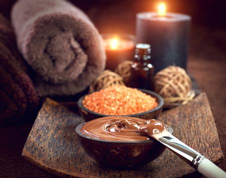 Foto de Spa treatment. Chocolate mask, bath salt, brown sugar scrub for skin - Imagen libre de derechos