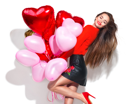 Foto de Valentine's Day. Beauty girl with colorful air balloons having fun, isolated on white background - Imagen libre de derechos