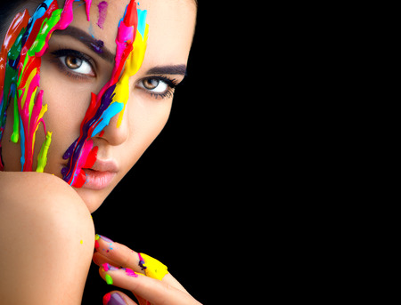 Photo pour Beauty model girl with colorful paint on her face. Portrait of beautiful woman with flowing liquid paint isolated on black - image libre de droit