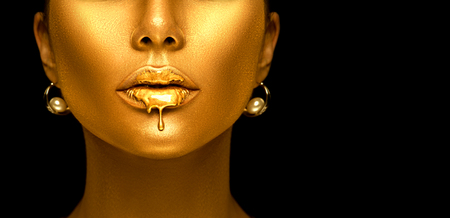 Foto de Gold paint drips from the sexy lips, golden liquid drops on beautiful model girl's mouth, creative abstract makeup. - Imagen libre de derechos