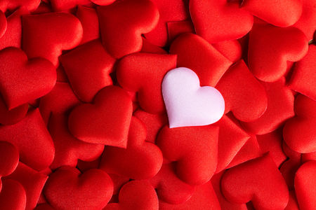 Foto de Valentine's Day. Holiday abstract red Valentine background with satin hearts. Love concept - Imagen libre de derechos