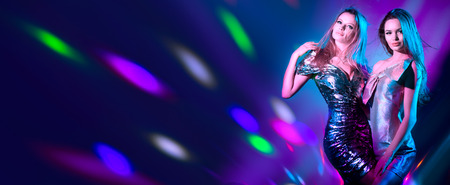 Photo for Hot model girls dancing in UV neon lights. Disco party. - Royalty Free Image