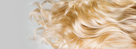 Photo for Hair. Beautiful healthy long curly blond hair closeup texture. Dyed wavy blonde hair background. Coloring concept. Haircare - Royalty Free Image