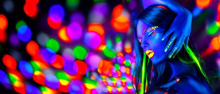 Photo for Sexy girl dancing in neon lights. Fashion model woman with fluorescent makeup posing in UV on bright - Royalty Free Image