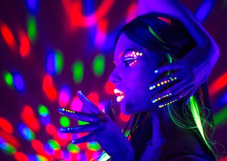 Photo for Fashion disco woman. Dancing model in neon light, portrait of beauty girl with fluorescent makeup. Art design - Royalty Free Image