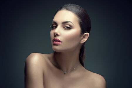 Photo pour Sexy beauty brunette woman with perfect makeup. Beauty girl's face on dark background. Skincare - image libre de droit