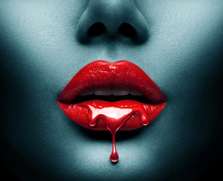 Photo pour Red Paint dripping on sexy lips - image libre de droit