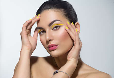 Photo for Beauty model girl with fashion make-up, Bright yellow eye line and nails, trendy manicure. - Royalty Free Image