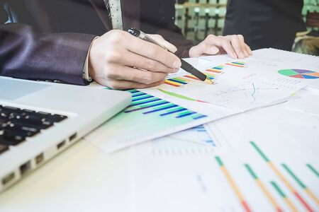 Foto de Asian Business man discussion and analysis data the charts and graphs showing the results at meeting. Business finances and accounting concept - Imagen libre de derechos