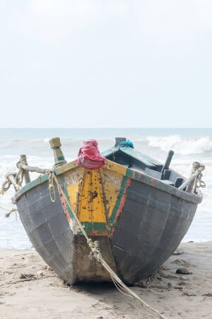 Photo pour An abandoned fishing boat trawler used in fishing industry spotted in a commercial dock near riverbank arena in a remote location of the Sundarbans jetty. Close up. Summer environment. - image libre de droit