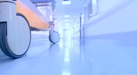 Bed in hospital corridor empty