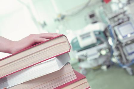 Photo pour Stack of books in hospital ward, concept of professional development. - image libre de droit