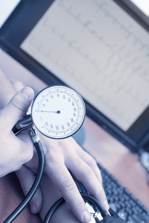 Measuring blood pressure in the doctor's office.