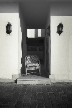 Symmetry of a lonely chair in the abandoned walls