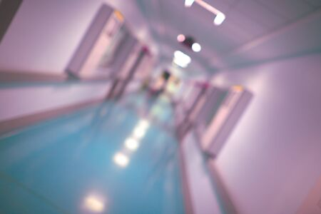 Photo pour Long hallway of a hospital building, unfocused background. - image libre de droit