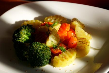 Boiled vegetables on white plate