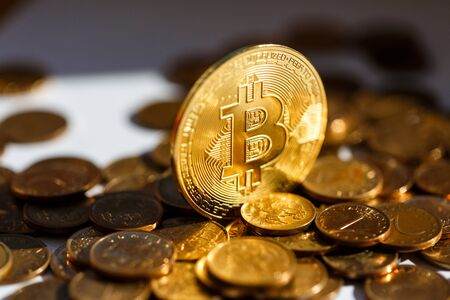 Finances of the future - Bitcoin cryptocurrency. Golden glitter luxury. close-up