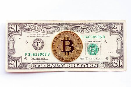 Photo pour Bitcoin on the background of the twenty dollar bill. Cryptocurrency vs. traditional economy. close-up - image libre de droit