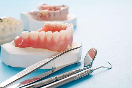 Photo pour Close up , Complete denture or full denture on blue background. - image libre de droit