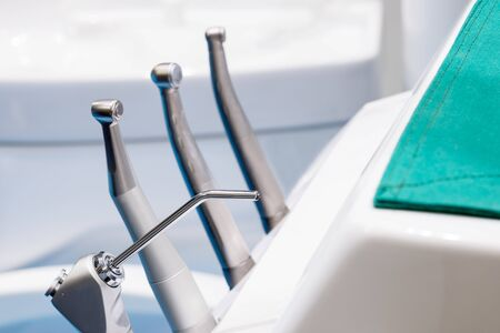 Photo pour Medical equipment and stomatology concep. Dental chair and other accesries used by dentists in the office. - image libre de droit