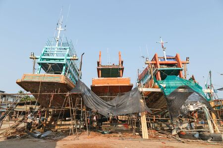 Fishing Boats in shipyard  and  Workers are repairing at Nakhon Si Thammarat Thailand on March 20, 2558