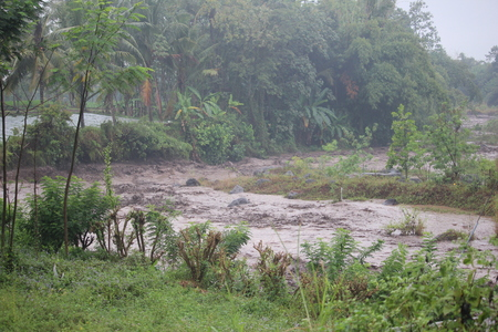 brown flood water from the summit of Mount Semeru , Bromo Tengger Semeru Park, Indonesia