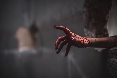 Foto de Nightmares of scary fear at the halloween festival. Close up bloody hands protruding from the wall, Horror and terror. - Imagen libre de derechos
