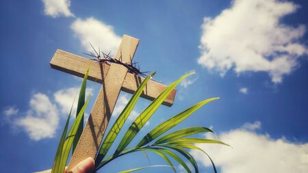 Photo for Lent,Holy Week and Good Friday concepts - photo of wooden cross raise up with sky background - Royalty Free Image