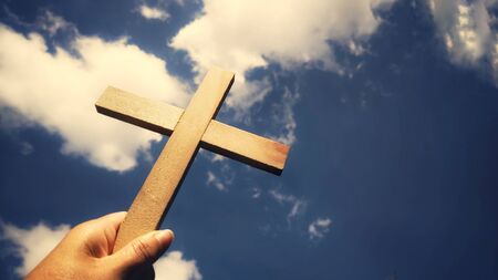 Photo for Lent Season,Holy Week and Good Friday concepts - image of wooden cross raise up to the sky - Royalty Free Image