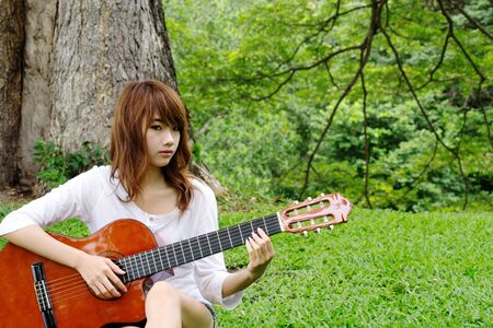 Asian pretty girl play classic guitar04