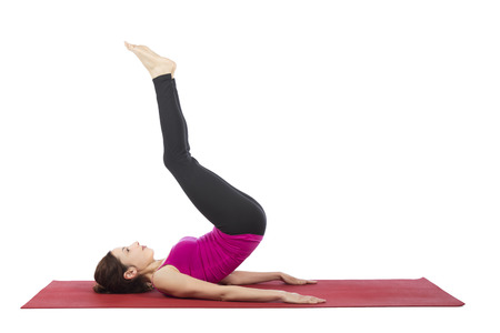 Woman is doing reverse crunch pose in fitness.